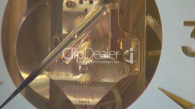 Clock gears close up in time lapse