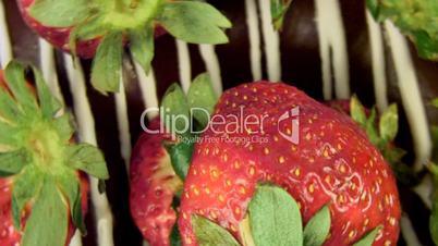 Strawberry and chocolate cake rotating