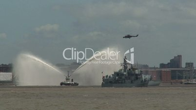 Fire tug, helicopter and Royal Navy warships