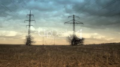 time lapse of running clouds with electricity pylon.