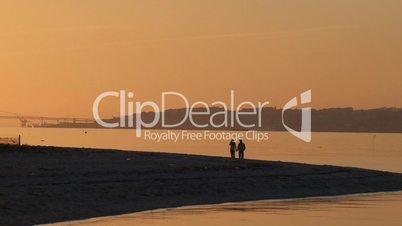 Man and woman walking at sunset