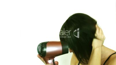 woman using a hair dryer, white background