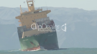 A time lapse of a container ship in a heavy swell