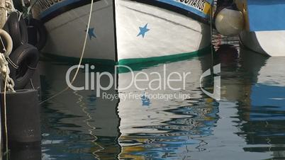 Fishing Boat in harbor reflected in the water