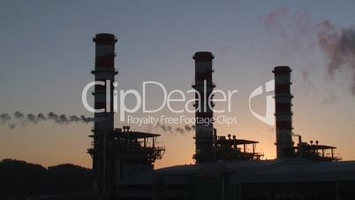 Complex of oil refinery at sunset