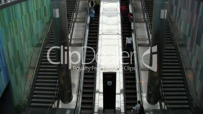 People taking escalator.