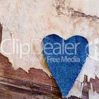 jeans heart on driftwood plank