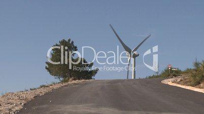 Wind turbine on top of the road