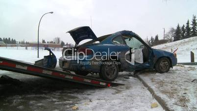 auto accident car onto tow truck