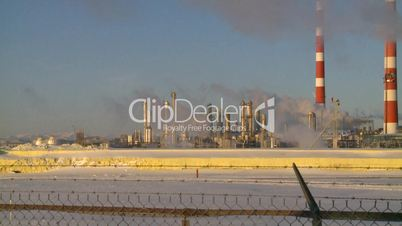 Gas plant at sunrise stacks steam