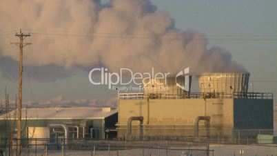 Gas plant at sunrise steam