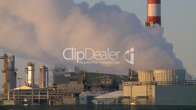 Gas plant at sunrise stacks