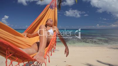 young woman in hammock close audio