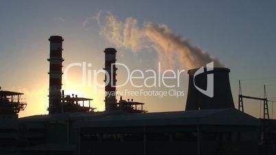 Power plant  at sunset smokestacks