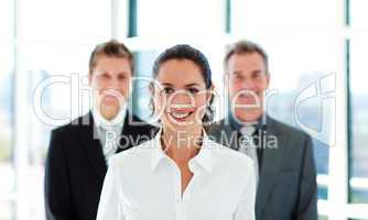 Smiling businesswoman with her team