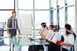 Senior businessman interacting with his team