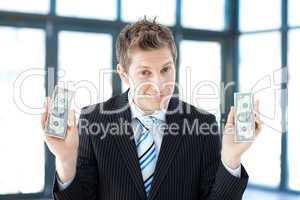 Businessman holding dollars