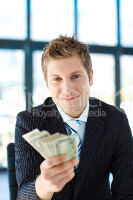 Junior businessman holding dollars