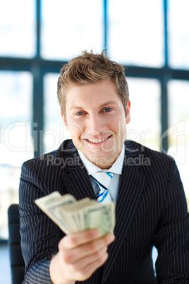 Junior businessman holding dollars