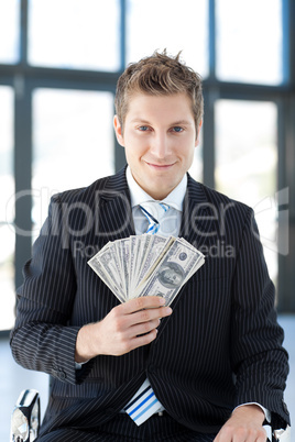businessman showing dollars