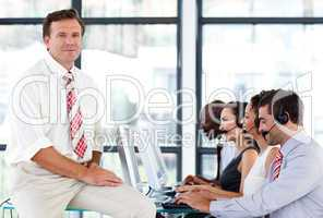 Confident senior manager in a call center