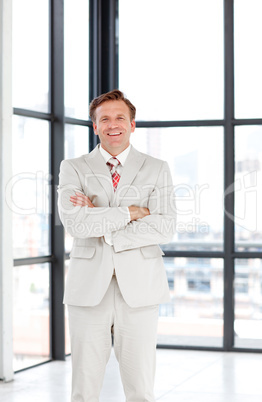 Senior businessman with folded arms