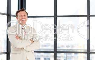 Smiling senior businessman with folded arms