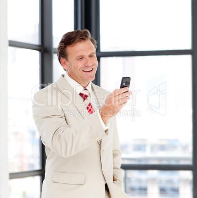 Portrait of a businessman sending a text