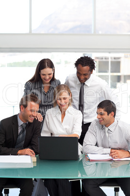 Businessteam working together with a laptop
