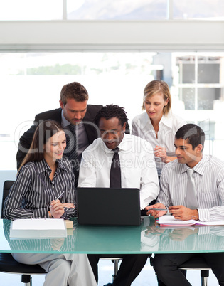 Business people using a laptop together