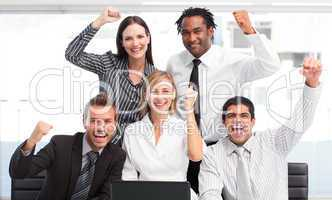 Enthusiastic business team celebrating success
