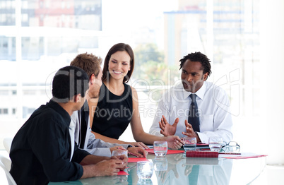 Business team interacting to each other in office