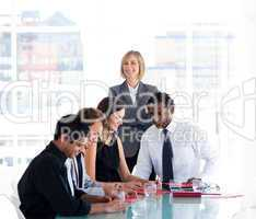 Female manager with her team in a meeting