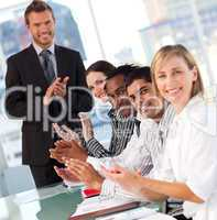 International business team clapping at the end of a presentatio