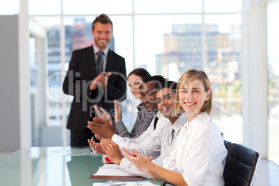 Happy manager clapping in a presentation