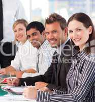 Businesswoman in an office with her colleagues