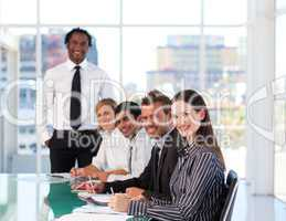Confident businesswoman attending a presentation