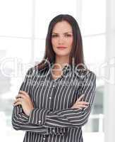Young businesswoman with folded arms