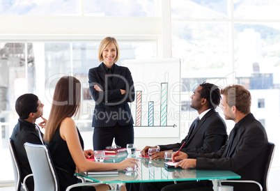 Businesswoman smiling with folded arms in a meeting