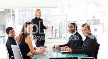 Businesswoman giving a presentation and smiling at the camera