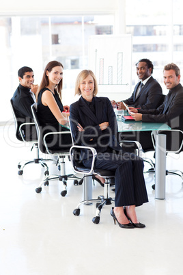 Smiling business team sitting in a presentation