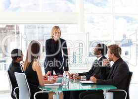 Businesswoman smiling at her colleagues in a meeting