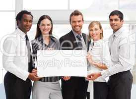 Business team holding a blank card