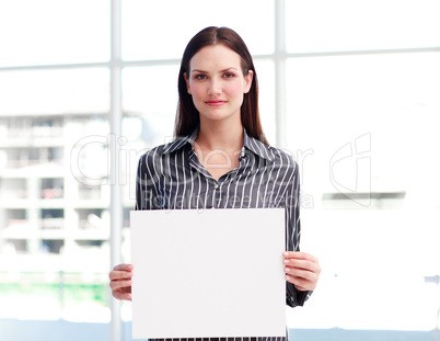 Businesswoman holding a busines card