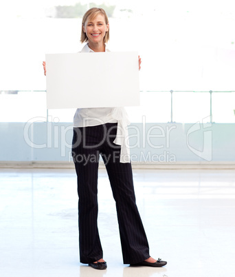Businesswoman holding a white  card