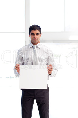 Serious businessman showing a white card