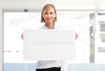 Mature woman showing a big business card