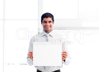Hispanic businessman showing a white card