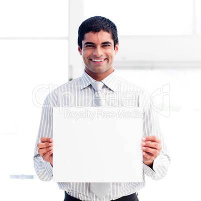 Portrait of a smiling businessman holding a white card