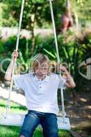 Kid having fun on a swing